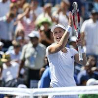 Photo - Ekaterina Makarova, of Russia, reacts after defeating Victoria Azarenka, of Belarus, in two sets during the quarterfinals of the 2014 U.S. Open tennis tournament, Wednesday, Sept. 3, 2014, in New York. (AP Photo/Mike Groll)