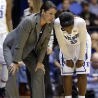 Photo - Duke coach Joanne P. McCallie, left, speaks with Alexis Jones during the second half of an NCAA college basketball game against Notre Dame in Durham, N.C., Sunday, Feb. 2, 2014. Notre Dame won 88-67. (AP Photo/Gerry Broome)