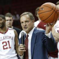 Photo - Oklahoma Head Coach Lon Kruger holds up the game ball after his 500th career win during a men's college basketball game between the University of Oklahoma and Northwestern Louisiana State University at the Lloyd Noble Center in Norman, Okla., Friday, Nov. 30, 2012.  Photo by Garett Fisbeck, The Oklahoman
