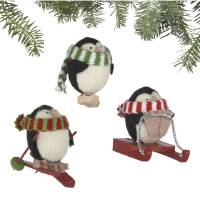 Photo - In this undated publicity image provided by Crate and Barrel, a set of three Alpaca Chubby Penguin ornaments made of soft alpaca blend wool by rural Peruvian women is shown. Crate and Barrel collaborated on the collection with a fair trade group that helps the women earn money to support and sustain their families. (AP Photo/Crate and Barrel)