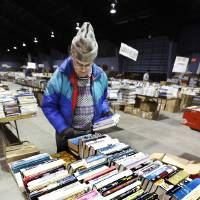 Photo - PREPARE / PREPARATION: Larry Eberhardt, Okla. City, sorting books on tables Tuesday, Feb. 16, 2010, for the annual Friends of the Library book sale this weekend in Oklahoma City. Photo by Paul B. Southerland, The Oklahoman ORG XMIT: KOD