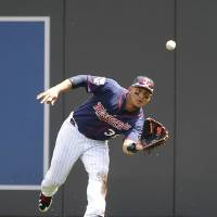 Photo - Minnesota Twins right fielder Oswaldo Arcia catches a flyout to right field by New York Yankees designated hitter Carlos Beltran during the fifth inning of a baseball game in Minneapolis, Sunday, July 6, 2014. (AP Photo/Ann Heisenfelt)