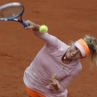 Photo - Russia's Maria Sharapova serves to compatriot Russia's Ksenia Pervak during the first round match of  the French Open tennis tournament at the Roland Garros stadium, in Paris, France, Monday, May 26, 2014. (AP Photo/Michel Euler)