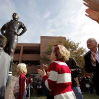 Photo - Barry Switzer looks up as a statue of himself is unveiled before the college football game between the Texas A&M Aggies and the University of Oklahoma Sooners (OU) at Gaylord Family-Oklahoma Memorial Stadium on Saturday, Nov. 5, 2011, in Norman, Okla. Photo by Bryan Terry, The Oklahoman