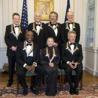 Photo - The 2012 Kennedy Center Honorees, from left, John Paul Jones, Buddy Guy, Jimmy Page, Natalia Makarova, Robert Plant, Dustin Hoffman, and David Letterman pose for a group photo after the State Department Dinner for the Kennedy Center Honors gala Saturday, Dec. 1, 2012 at the State Department in Washington. (AP Photo/Kevin Wolf)