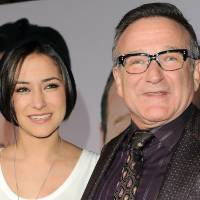 Photo - FILE - This Nov. 9, 2009 file photo shows Zelda Williams, left, with her father Robin Williams at the premiere of