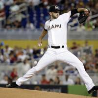 Photo - Miami Marlins starting pitcher Jarred Cosart throws in the first inning during a baseball game against the St. Louis Cardinals, Tuesday, Aug. 12, 2014, in Miami. (AP Photo/Lynne Sladky)