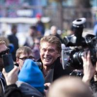 Photo - US actor David Hasselhoff, center, arrives for a protest against the removal of a section of the East Side Gallery, a historic part of former Berlin Wall, in Berlin, Sunday, March 17, 2013. Hasselhoff is fondly remembered by many Germans for releasing a song called