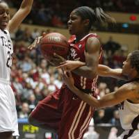 Photo - OU's Aaryn Ellenberg (3) goes to the basket between Texas A&m's Adaora Elonu (21), left, and Sydney Carter (4)during the women's college basketball Big 12 Championship tournament game between the University of Oklahoma and Texas A&M in Kansas City, Mo., Friday, March 11, 2011.  Photo by Bryan Terry, The Oklahoman