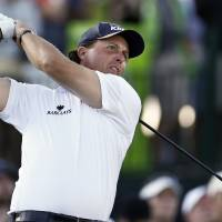 Photo - Phil Mickelson hits his tee shot on the 17th hole during the second round of the Waste Management Phoenix Open golf tournament on Friday, Feb. 1, 2013, in Scottsdale, Ariz. (AP Photo/Ross D. Franklin)