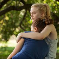 Photo - This undated publicity film image provided by the Sundance Institute shows Dakota Fanning, right, and Elizabeth Olsen, in the film