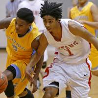 Photo - Carl Albert's Malik Barnett, right, and Putnam CIty West's Omega Hrris go for the ball during their high school basketball game at Carl Albert in Midwest City, Okla., Friday, Jan. 25, 2013. Photo by Bryan Terry, The Oklahoman