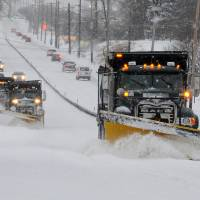 Photo - FILE - In this Feb. 13, 2014 file photo a line of trucks with plows head south on Route 202 between Dilworthtown Road and Route 1 in Birmingham Township, Pa. As spring officially begins Thursday, officials across much of the nation are still paying the bills for keeping roads clear during the cold, snowy winter. In Pennsylvania, legislators have approved special appropriations that will help but won't pay for everything. (AP Photo/Philadelphia Inquirer, Clem Murray, File)