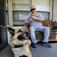 Photo - Gordan Allen Besaw, a blind veteran, sits on the front porch of his home with his service dog, Derby, Wednesday afternoon, May 1, 2013.  Besaw was attacked earlier this week when walking to a bus stop with his seeing eye dog. He said he relied on Army training to take down his attacker who was arrested by police.  Besaw was not injured. He lives near NW 23 and Donald  in Bethany. Photo  by Jim Beckel, The Oklahoman.