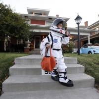 Photo -  Alex Spiropoulos, 4, trick or treats, Saturday Oct. 30, 2010, in the Mesta Park  Neighborhood in Oklahoma City. Photo by Sarah Phipps, The Oklahoman