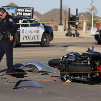 Photo - Edmond police investigate a crash Sunday near W 33 and N Lincoln Boulevard in Edmond. Photos by Sarah Phipps, The Oklahoman