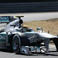 Photo - Mercedes driver Lewis Hamilton of Britain steers his car during the Hungarian Formula One race at the Hungaroring racetrack near Budapest, Hungary, Sunday, July 28, 2013. (AP Photo/Petr David Josek)