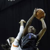 Photo - Duke Blue Devils forward/center Elizabeth Williams (1) prepares to shoot as Miami Hurricanes guard Caprice Dennis (1) defends  during the second half of an NCAA college basketball game in Coral Gables, Fla., Thursday, Jan. 30, 2014. Duke won 76-75. (AP Photo)