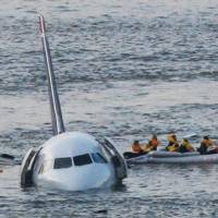 Photo -   FILE - In this Jan. 15, 2009 file photo, passengers in an inflatable raft move away from an Airbus 320 US Airways aircraft that has gone down in the Hudson River in New York. The day after geese hit a second airliner and forced it to make an emergency landing at a New York airport, U.S. Sen. Kirsten Gillibrand, D-NY, introduced legislation Wednesday, April 25, 2012 that would make it easier to round up geese near JFK Airport and kill them. (AP Photo/Bebeto Matthews, File)