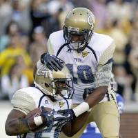 Photo -   Georgia Tech running back David Sims, left, celebrates after scoring a touchdown with teammate Synjyn Days, right, in the first quarter of an NCAA college football game against Duke, Saturday, Nov. 17, 2012, in Atlanta. (AP Photo/David Goldman)