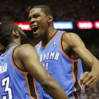Photo - Oklahoma City's James Harden (13) and Kevin Durant (35) celebrate after a  Harden basket and foul during Game 5 of the Western Conference Finals between the Oklahoma City Thunder and the San Antonio Spurs in the NBA basketball playoffs at the AT&T Center in San Antonio, Monday, June 4, 2012. Photo by Nate Billings, The Oklahoman