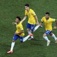 Photo - Brazil's Neymar, left, celebrates scoring his side's first goal during the group A World Cup soccer match between Brazil and Croatia, the opening game of the tournament, in the Itaquerao Stadium in Sao Paulo, Brazil, Thursday, June 12, 2014.  (AP Photo/Shuji Kajiyama)