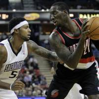 Photo -   Sacramento Kings forward James Johnson, left, defends against Portland Trail Blazers forward J.J. Hickson during the first half of an NBA basketball game in Sacramento, Calif., Tuesday, Nov. 13, 2012. (AP Photo/Rich Pedroncelli)