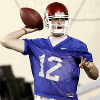 Photo - OU / COLLEGE FOOTBALL / SPRING PRACTICE: Oklahoma Sooners quarterback Landry Jones throws a pass during practice at the Everest Training Facility on the University of Oklahoma campus in Norman on Monday, March 8, 2010. Photo by John Clanton, The Oklahoman ORG XMIT: KOD
