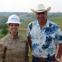 Photo - Miranda Jones, vice president of environmental safety and regulatory at Crestwood Midstream Partners, and Tex Hall, chairman of the Three Affiliated Tribes, pose for a photo near the site of a pipeline spill near Mandaree, N.D., Wednesday, July 9, 2014. A pipeline owned by a Crestwood subsidiary leaked around 1 million gallons of saltwater. Some of that liquid entered a bay that leads to a lake that is used for drinking water by the Three Affiliated Tribes. (AP Photo/Josh Wood)