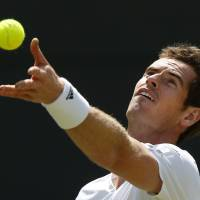 Photo - Andy Murray of Britain serves Biaz Rola of Slovenia during their men's singles match at the All England Lawn Tennis Championships in Wimbledon, London, Wednesday, June 25, 2014. (AP Photo/Sang Tan)