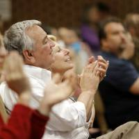 Photo -  Dave Lopez, interim superintendent of the Oklahoma City Public School District, and his wife, Lana, applaud after a song performed after the final concert of the inaugural season performed recently by El Sistema Oklahoma students at St. Luke's United Methodist Church, 222 NW 15. Photo by Doug Hoke, The Oklahoman   DOUG HOKE -
