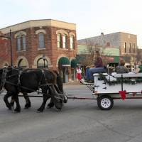 Photo - Wendy Meyer drives a team of horses in downtown Edmond on  Thursday. Photo by Sarah Phipps, The Oklahoman  SARAH PHIPPS - SARAH PHIPPS