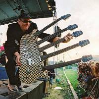 Photo - Cheap Trick guitarist Rick Nielsen brandishes one of his most outrageous instruments. PHOTO PROVIDED