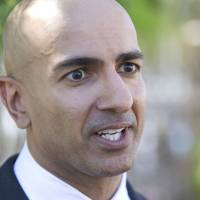 Photo - Republican candidate for governor Neel Kashkari discusses issues related to poverty in California during a news conference outside of the River City Food Bank in Sacramento, Calif., on Thursday, July 31, 2014. Kashkari said he spent a week living as a homeless person in search of a job to test Gov. Jerry Brown's claim that the state is making a comeback after the economic downturn. A video crew documented his week. (AP Photo/Steve Yeater)