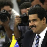 Photo -   FILE - In this July 30, 2012 file photo Venezuela's Foreign Minister Nicolas Maduro smiles during a meeting ahead a Southern Common Market (MERCOSUR) Summit in Brasilia, Brazil. Venezuela's President Hugo Chavez on Wednesday, Oct. 10, 2012, named Nicolas Maduro as his new vice president. Maduro, a former National Assembly member, has headed the foreign ministry since 2006, and is seen as one of the administration's hard-liners. (AP Photo/Eraldo Peres, file)