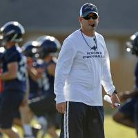 Photo - Southmoore football coach Jeremy Stark watches during practice at Southmoore High School in Moore, Wednesday, August 13, 2014. Photo by Bryan Terry, The Oklahoman