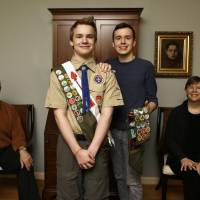 Photo - In this Monday, Feb. 4, 2013 photo, Pascal Tessier, 16, center left, a Boy Scout, and his brother Lucien Tessier, 20, who had earned the rank of Eagle Scout, pose for a portrait with their parents, Oliver Tessier, left, and Tracie Felker, at their home in Kensington, Md. The two Tessier boys enjoyed Cub Scouts, progressed to Boy Scouts, and continued to thrive there even as many in their troop became aware that each boy was gay. The family is grateful for that, but fervently hopes the BSA's top leaders officially scrap the ban so that open acceptance becomes the norm for Scout units nationwide. (AP Photo/Jacquelyn Martin)