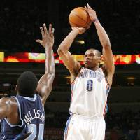 Photo - Oklahoma City's Russell Westbrook shoots over Utah's Paul Millsap during the Thunder's 119-111 win Sunday at the Ford Center.  PHOTO BY SARAH PHIPPS, THE OKLAHOMAN