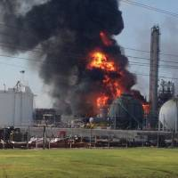 Photo - This photo provided by Ryan Meador shows an explosion at The Williams Companies Inc. plant in the Ascension Parish town of Geismar La., Thursday, June 13, 2013. The fire broke out Thursday morning at the plant, which the company's website says puts out about 1.3 billion pounds of ethylene and 90 million pounds of polymer grade propylene a year. (AP Photo/Ryan Meador)