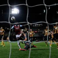 Photo - Hull City's goalkeeper Allan McGregor, center right, brings down West Ham's Mohamed Diame, center left, for a penalty and was red carded for the challenge during the English Premier League soccer match between West Ham and Hull City at Upton Park stadium in London, Wednesday, March 26, 2014.  (AP Photo/Matt Dunham)
