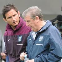 Photo - England manager Roy Hodgson, left, and Frank Lampard talk during a training session at George's Park in Burton on Trent, England, Tuesday, May 27, 2014. England play an international soccer friendly against Peru at Wembley on Friday May 30th. (AP Photo/Rui Vieira)