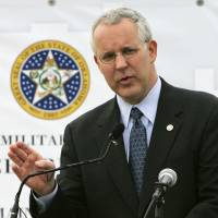 Photo - Oklahoma Gov. Brad Henry gestures as he speaks during ground breaking ceremonies for the first of seven BRAC Armed Forces Reserve Centers scheduled for construction in the state,  to in Norman, Okla., Tuesday, Sept. 9, 2008. (AP Photo) ORG XMIT: OKSO107
