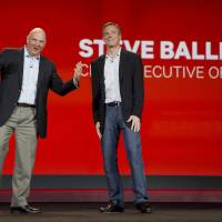 Photo - Microsoft CEO Steve Ballmer, left, and Qualcomm CEO Paul Jacobs speak during Jacobs' keynote address at the Consumer Electronics Show, Monday, Jan. 7, 2013, in Las Vegas. (AP Photo/Julie Jacobson)