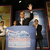 Photo -   Republican presidential candidate, former Massachusetts Gov. Mitt Romney speaks at a Colorado Conservative Political Action Committee (CPAC) meeting in Denver, Thursday, Oct. 4, 2012. At rear are sons Matt, Craig, Tagg, Josh Romney. (AP Photo/Charles Dharapak)