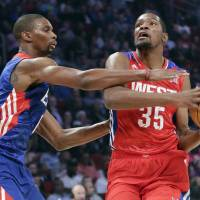Photo - East Team's Chris Bosh of the Miami Heat guards West Team's Kevin Durant of the Oklahoma City Thunder during the first half of the NBA All-Star basketball game Sunday, Feb. 17, 2013, in Houston. (AP Photo/Eric Gay) ORG XMIT: HTR133