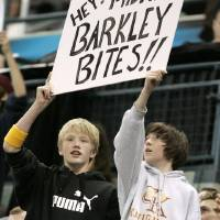 Photo - FAN: Fans hold a sign in reaction to Charles Barkley's comments from the previous night during the New Orleans/Oklahoma City Hornets NBA basketball game against the New York Knicks at the Ford Center in Oklahoma City, Feb. 10, 2006.  By Bryan Terry/The Okahoman