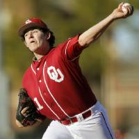 Photo - Jacob Evans (11) pitches for Oklahoma during OU's season-opening college baseball game against Seton Hall at L. Dale Mitchell Park in Norman,  Okla., Friday, Feb. 14, 2014. Photo by Nate Billings, The Oklahoman