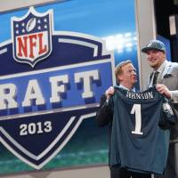 Photo -  Former Oklahoma offensive tackle Lane Johnson, right, was selected fourth overall by the Philadelphia Eagles in last month's NFL Draft. AP PHOTO