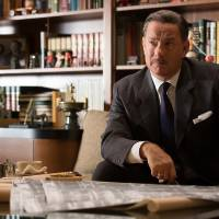 Photo - This image released by Disney shows Tom Hanks as Walt Disney in a scene from