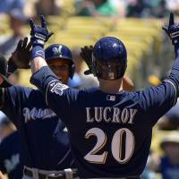Photo - Milwaukee Brewers' Jonathan Lucroy, right, is congratulated by Carlos Gomez after hitting a two-run home run during the first inning of a baseball game against the Los Angeles Dodgers, Sunday, Aug. 17, 2014, in Los Angeles. (AP Photo/Mark J. Terrill)